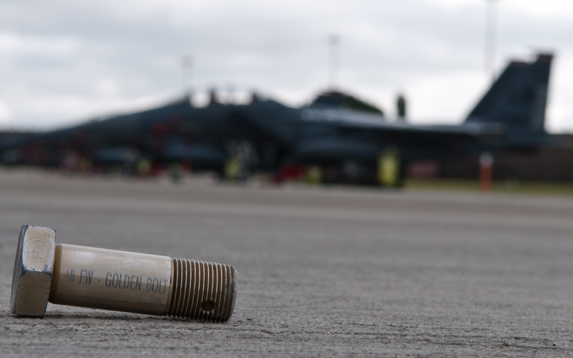 ROYAL AIR FORCE LAKENHEATH, England -- The 48th Fighter Wing Golden Bolt sits on the flightline as a piece of Foreign Object Debris Aug. 30, 2012. Each month the golden bolt is placed somewhere on the flightline. If anyone finds the bolt and picks it up, they receive a day pass amongst other prizes from the 48th FW FOD Prevention Incentive Program. (U.S. Air Force photo by Senior Airman Connor Estes)