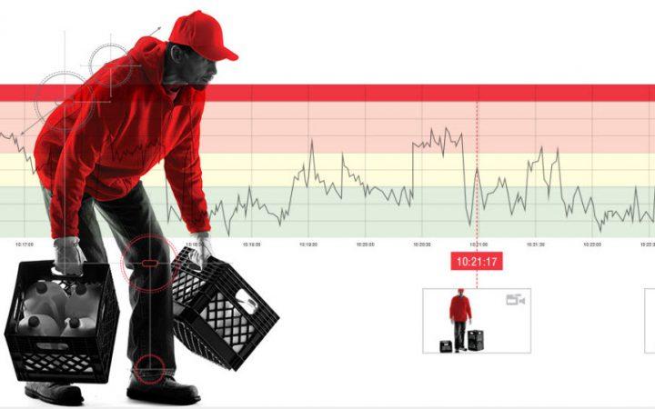 Trabajador cargado con cajas y gráfica de paramétros físicos de fondo