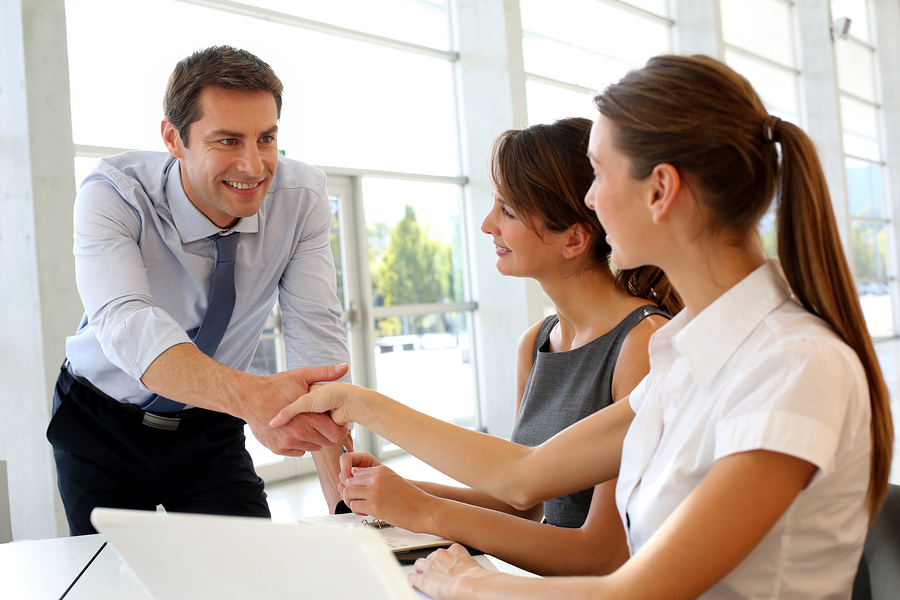 women-shaking-hands